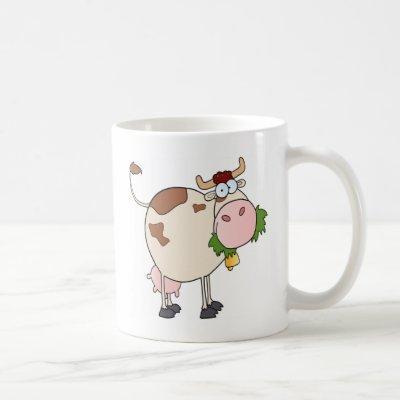 Cartoon cow eating grass coffee mug