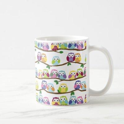 Colorful owls on a branch coffee mug