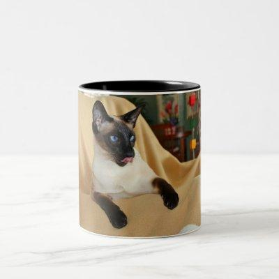 Comical Seal Point Siamese Cat Licking It's Nose Two-Tone Coffee Mug