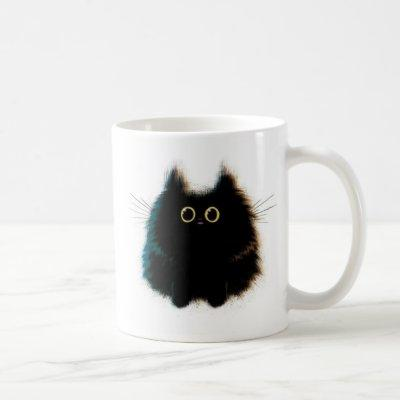 Funny fluffy cat on coffee mug
