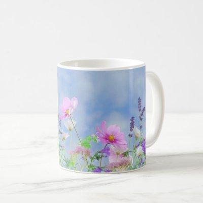 Meadow with beautiful pastel wildflowers coffee mug