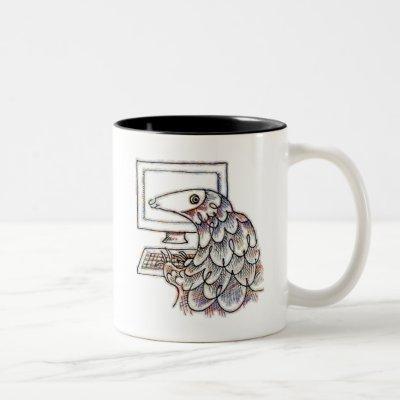 Pangolin on a computer Two-Tone coffee mug